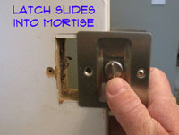 Sliding a Pocket Door Lock Into the Mortise